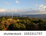 Small photo of Wind turbines at sunset in Grighine mountain, Allai, Sardinia, Italy