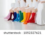 kids wearing colorful rainbow... | Shutterstock . vector #1052327621
