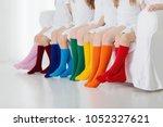 kids wearing colorful rainbow...   Shutterstock . vector #1052327621