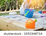picture of kids playing in sand ... | Shutterstock . vector #1052348714