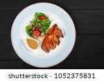 grilled meat steak and salad... | Shutterstock . vector #1052375831