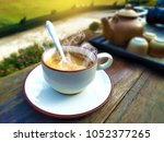 morning time with hot coffee... | Shutterstock . vector #1052377265