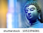 buddha face on the blue backdrop | Shutterstock . vector #1052396081