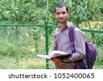 indian student in outdoor with... | Shutterstock . vector #1052400065