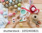 happy easter  a woman hand...   Shutterstock . vector #1052403821