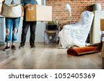 couple moving into new house | Shutterstock . vector #1052405369