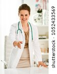 smiling medical doctor woman in ... | Shutterstock . vector #1052433569