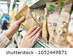 buyer hands with the packaging... | Shutterstock . vector #1052449871