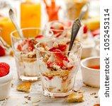 natural yogurt with fresh... | Shutterstock . vector #1052453114
