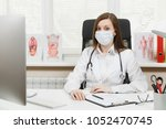 young female doctor sitting at... | Shutterstock . vector #1052470745