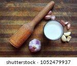 milk in glass   garlic with... | Shutterstock . vector #1052479937