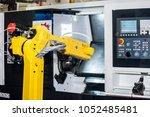 yellow robot hand in cnc... | Shutterstock . vector #1052485481