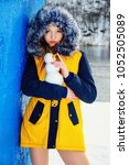 girl in yellow fur coat with a... | Shutterstock . vector #1052505089