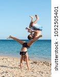 couple having fun doing jumps...   Shutterstock . vector #1052505401