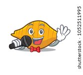 singing conchiglie pasta mascot ... | Shutterstock .eps vector #1052511995