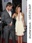 LOS ANGELES, CA - JANUARY 11, 2012: Miley Cyrus & Liam Hemsworth at the 2012 People's Choice Awards at the Nokia Theatre L.A. Live. January 11, 2012  Los Angeles, CA - stock photo