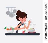 women cooking in prepares... | Shutterstock .eps vector #1052514821