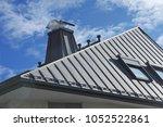 modern standig seam metal roof...   Shutterstock . vector #1052522861