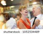 romantic senior couple dancing... | Shutterstock . vector #1052534489