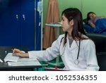 woman doctor with stethoscope... | Shutterstock . vector #1052536355