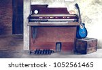 old piano and  old guitar  | Shutterstock . vector #1052561465