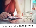 woman and small shopping cart...   Shutterstock . vector #1052562827