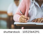 students writing and reading... | Shutterstock . vector #1052564291