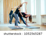 fitness lady beginning yoga... | Shutterstock . vector #1052565287