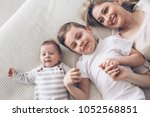 young mom with her 5 years old... | Shutterstock . vector #1052568851