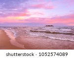 pink sunset on lake beach sea... | Shutterstock . vector #1052574089
