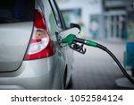car refueling on a petrol... | Shutterstock . vector #1052584124