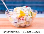tropical fruit salad with... | Shutterstock . vector #1052586221