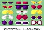 set of summer sunglasses.... | Shutterstock .eps vector #1052625509
