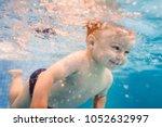 little baby  boy swimming under ... | Shutterstock . vector #1052632997