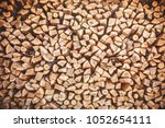 the firewood put at each other  ... | Shutterstock . vector #1052654111