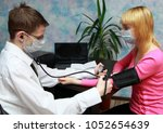 male doctor measures the... | Shutterstock . vector #1052654639