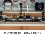 round bottles with olive oil... | Shutterstock . vector #1052658749