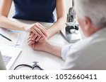 female doctor is holding a hand ... | Shutterstock . vector #1052660411