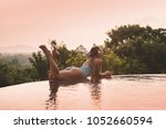 young woman in swimsuit... | Shutterstock . vector #1052660594