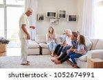 multi generation family sitting ... | Shutterstock . vector #1052674991