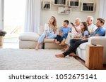 multi generation family sitting ... | Shutterstock . vector #1052675141