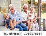 grandparents with grandchildren ... | Shutterstock . vector #1052678969