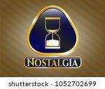 golden emblem or badge with... | Shutterstock .eps vector #1052702699