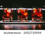 glass of iced cocktail on bar... | Shutterstock . vector #1052710934