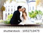 bride a groom sitting back on... | Shutterstock . vector #1052713475