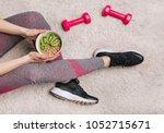 girl in sporting elk holds a... | Shutterstock . vector #1052715671