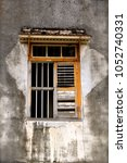 small barred window in a... | Shutterstock . vector #1052740331