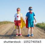 children acting like a superhero   Shutterstock . vector #1052740565