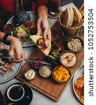 mezze platter served with pita  ... | Shutterstock . vector #1052753504