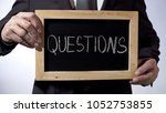 questions written on blackboard ... | Shutterstock . vector #1052753855